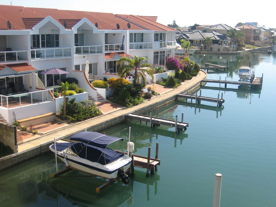 Port Sails Canal Villa, Mandurah is the second villa on the left with the blue umbrella
