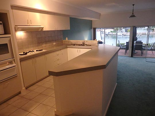 Watch for dolphins whilst doing the dishes. Mandurah Canal kitchen with fridge freezer, oven, cook top, dishwasher and pantry