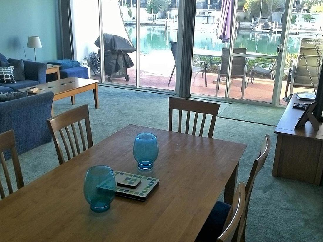 "Lounge room with 42"" widescreen TV and Foxtel and canal views at Port Sails Canal Villa, Mandurah accommodation"