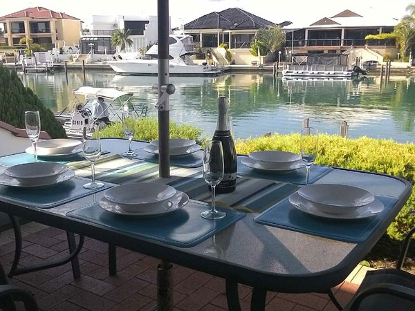 Outdoor alfresco entertaining with Mandurah canal views