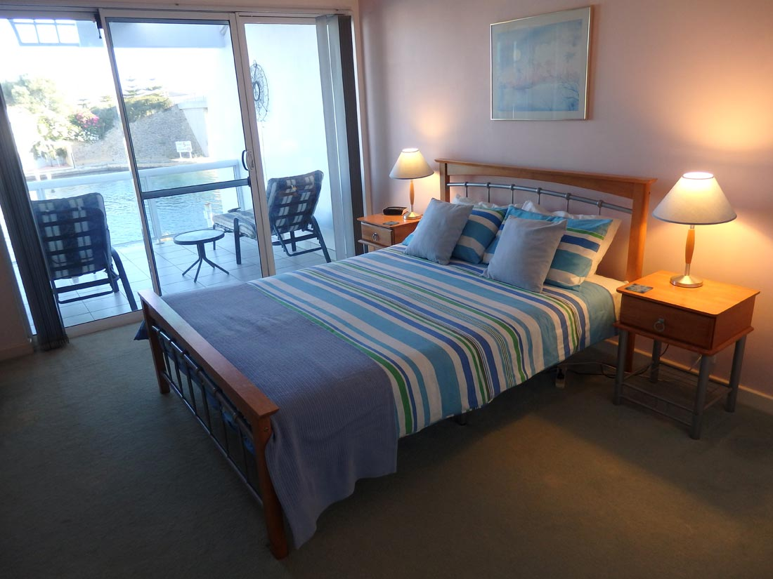 Master bedroom at Port Sails Canal Villa, Mandurah with ensuite and balcony