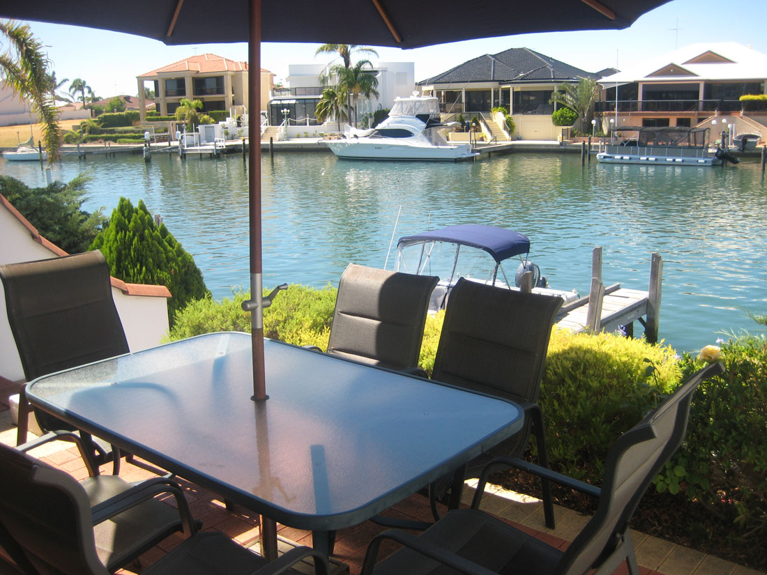 Port Sails Canal Villa, Mandurah accommodation outdoor entertaining BBQ area seats 6 people with canal views