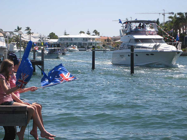 Flotilla of boats parade past our Mandurah jetty for Australia Day