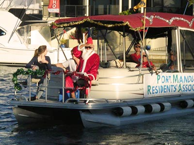 Santa visits Port Mandurah Canal jetties on Christmas Eve